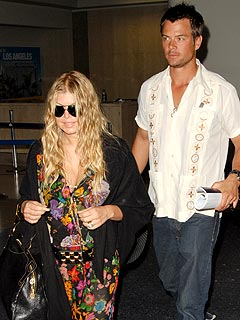 <b>Fergie And Josh Rock...</b>