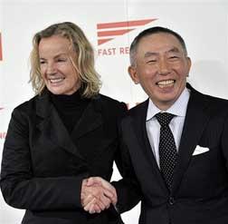 Jil Sander shakes hands with Uniqlo brand president Tadashi Yanai