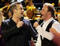Robbie Williams and Gary Barlow on stage