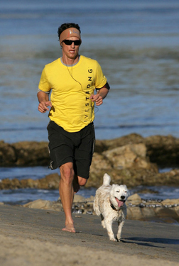 Matthew McConaughey jogs with dog BJ in Malibu‏