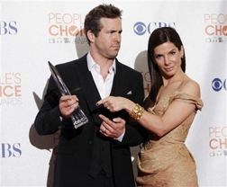 Sandra Bullock with shares her award with Ryan