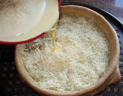 Deep Gruyere Quiche - Spinkle cheese on the base and pour on mixture