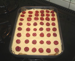 Dot the raspberries on top before baking