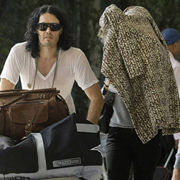 Katy Perry hiding under her coat with Russell Brand in Jaipur