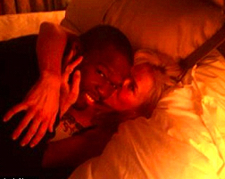 50 Cent having a snuggle with Chelsea Handler