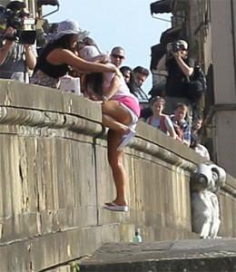 Deena nearly falling off the bridge