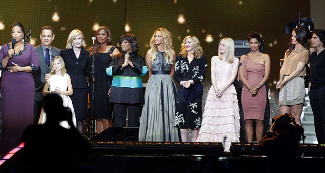 From left Oprah on stage with guests including Tom Hanks, Queen Latifah, Madonna, Dakota, Halle, Katie Holmes and Tom Cruise