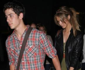 Nick Jonas and Deltra Goodrem spotted out holding hands