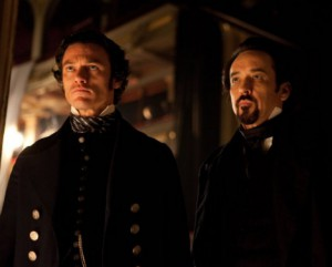 Luke Evans and John Cusack in The Raven