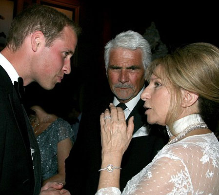 Prince William chatting with Barbara Streisand and her husband James Brolin