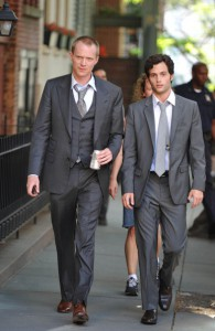 Paul Bettany with Penn Badgley on the set of Margin Call