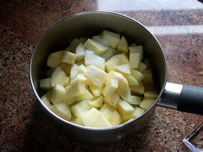 Place the apples in a pan and cook down