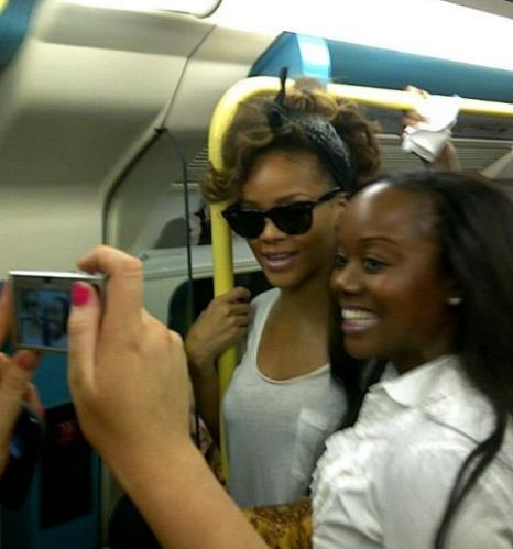 Rihanna on the Jubilee Line posing with fans
