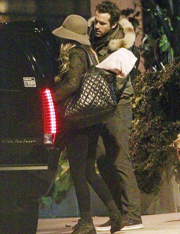 Ryan Reynolds leaving his apartment with Blake Lively