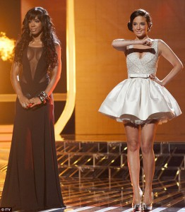 X Factor judges Kelly Rowland and Tulisa Contostavlos