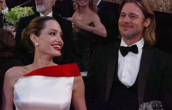 Angelina Jolie and Brad Pitt chuckling at his jokes