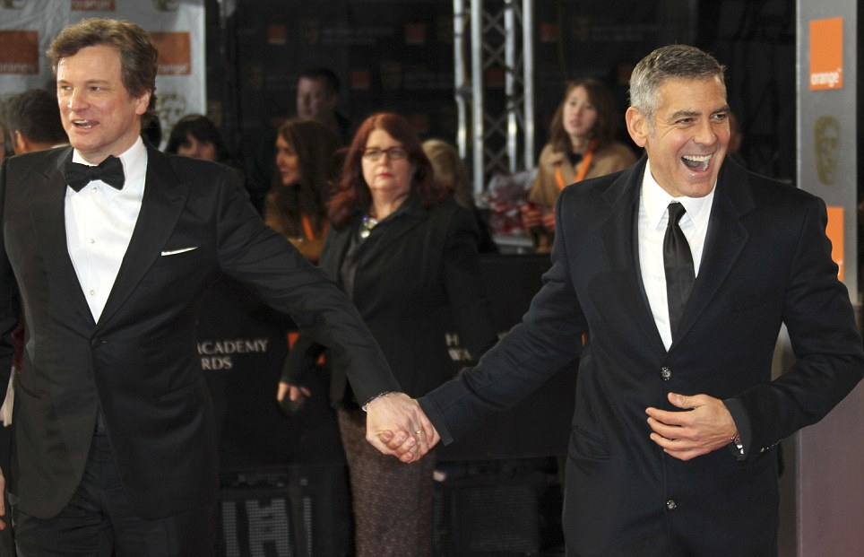 Colin Firth and George Clooney getting close on the red carpet