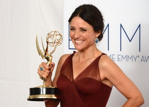Julia Louis-Dreyfus posing with her Emmy Award
