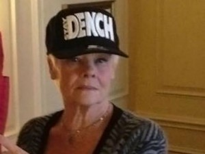 Dame Judi Dench wearing the Lethal Bizzle Dench cap