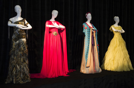 Left to right: Roberto Cavalli's Pocahontas dress; Escada's gown for Princess Jasmine; Missoni's design for Mulan and Valentino's gown for Belle from Beauty and the Beast.