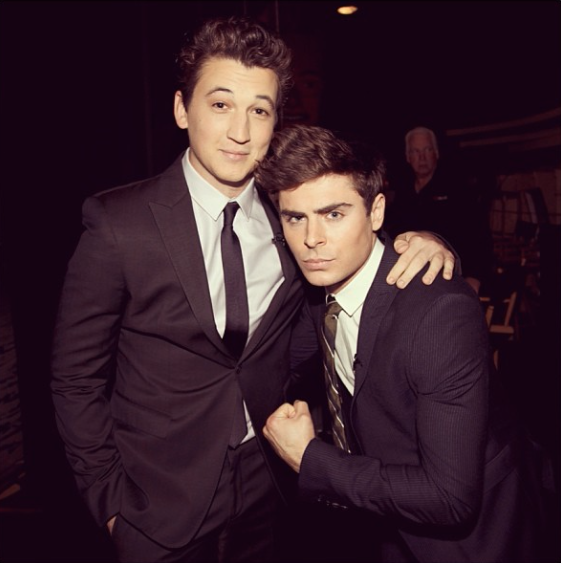 Miles looking super cute in a suit with Zac Efron.