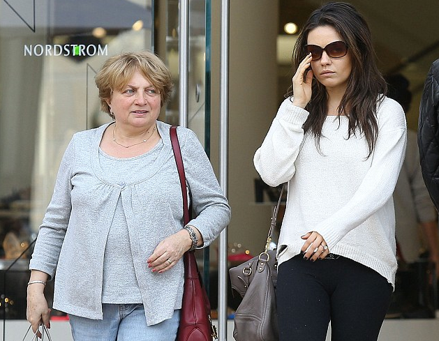 Mila Kunis takes an outing with her mother...spot the ring!