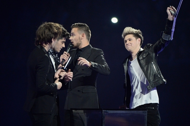 One Direction's Niall Horan celebrates Harry Styles's arrival onstage.