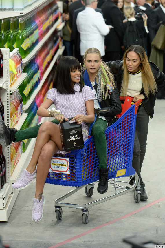 Rihanna with Cara Delevigne and Joan Smalls at the Chanel show during Paris Fashion Week.