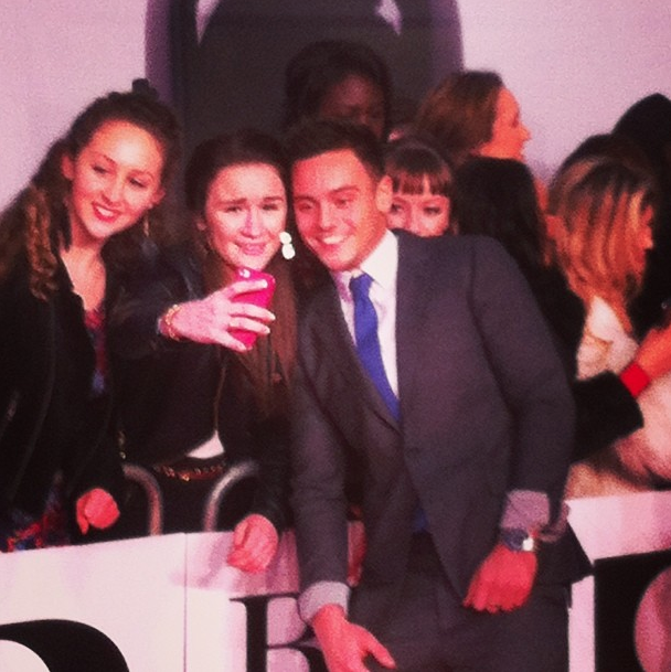 Tom Daley taking pictures with fans