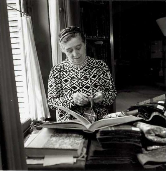 Jeanne Lanvin chooses fabrics in her office, 1936.