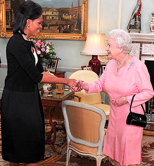 Michelle Obama shaking hands with the Queen of England